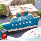 Truck Ferry Christmas and New Year's card with a cookie ship